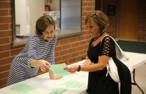 PTO President Amy Shroud gives information to parent during open house