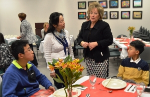 Chinese guests and DMS students enjoy lunch at the PHM central office staff